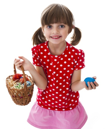 little girl holding basket with easter eggs photo
