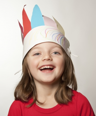 portrait of little girl with Indian headband made of paper - carnival  photo
