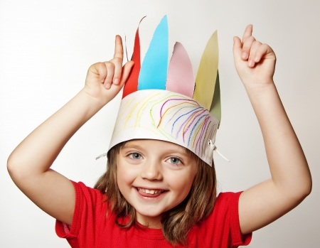 portrait of little girl with Indian headband made of paper - carnival mask  photo