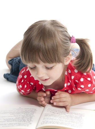 little girl reading a book photo