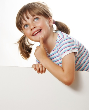 little girl with white blank with empty space for text or picture Stock Photo - 18299426
