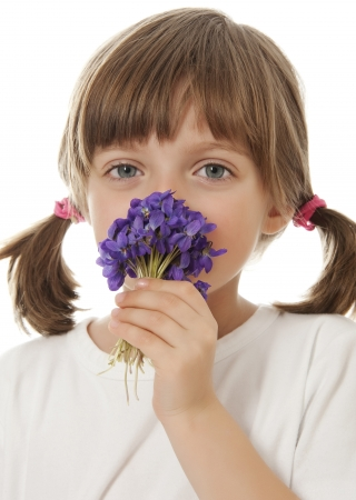 violets: little girl with a bouquet of violets
