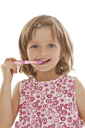 little girl brushing teeth  photo