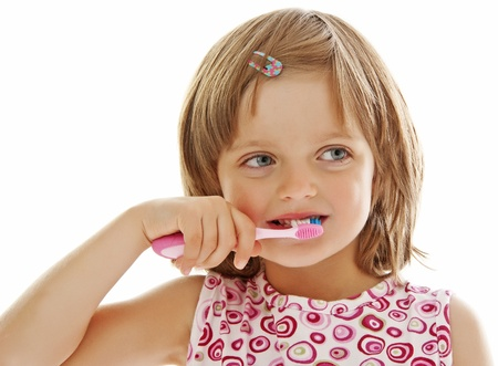 portrait of a little girl brushing teeth  photo