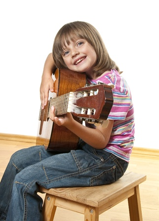 girl playing guitar: little girl playing guitar Stock Photo