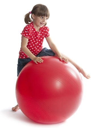 little girl with a red ball photo