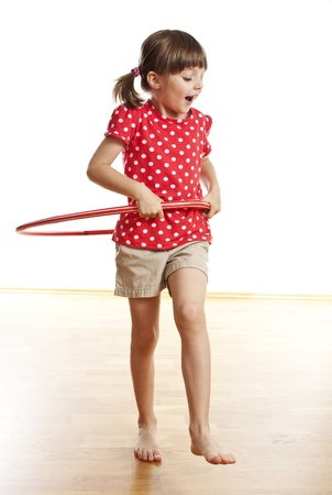 aerobic treatment: little girl doing exercise with a red hoop Stock Photo