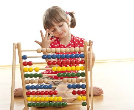 counting little girl with abacus