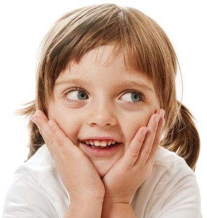 ponytails: portrait of happy little girl