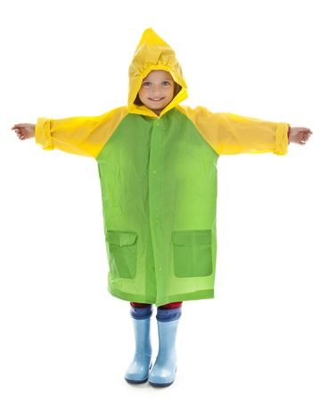 gum boots: little girl with raincoat and gum boots isolated  Stock Photo