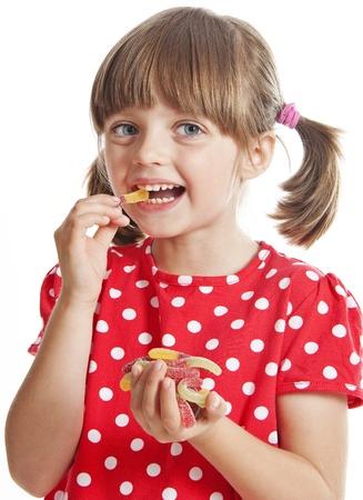 gelatine: little girl eating gelatine candy Stock Photo