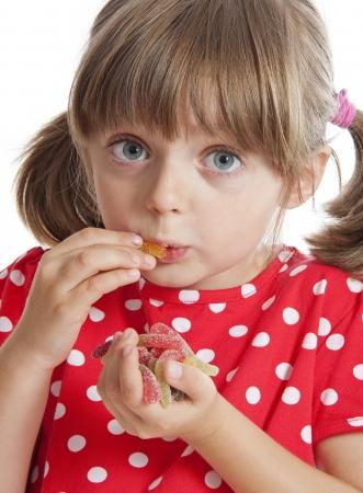 gelatine: little girl eating gelatine sweets Stock Photo