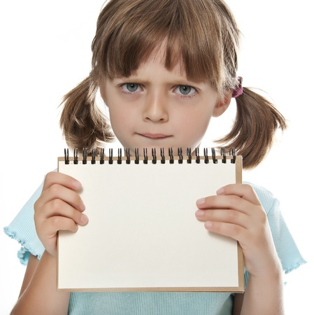 little girl holding empty white notebook  photo