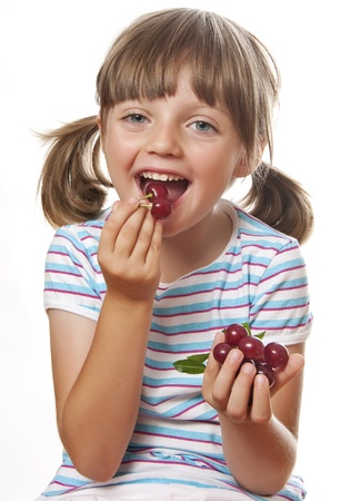 happy little girl eating cherries photo