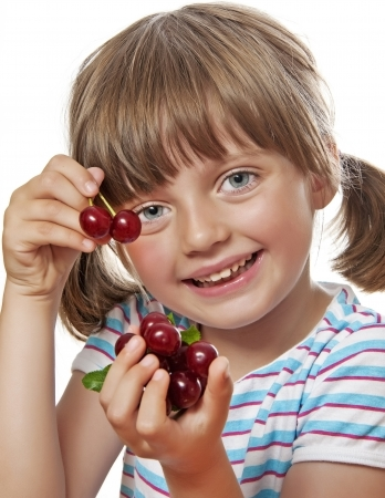little girl eating cherries photo