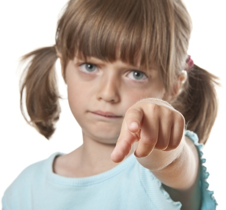 angry little girl pointing on you Stock Photo