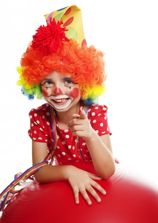happy little clown pointing on something photo