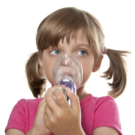 asthma: ill little girl using inhaler - respiratory problems