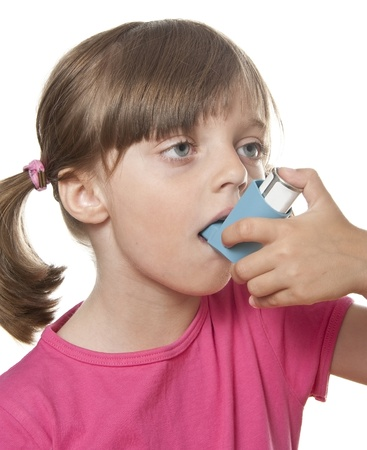 little girl using inhaler - respiratory problems isolated on white background photo
