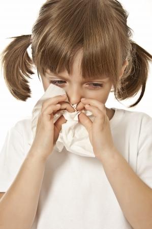 catarrh: portrait of little girl with handkerchief  - allergy