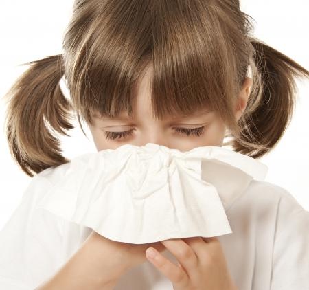 catarrh:  ill little girl with handkerchief  Stock Photo