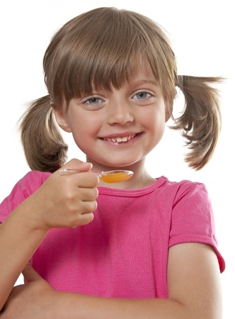 happy little girl with a syrup for cough photo