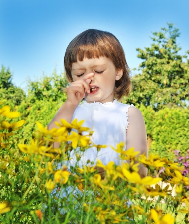 little girl sneezing - pollen fever allergy  photo