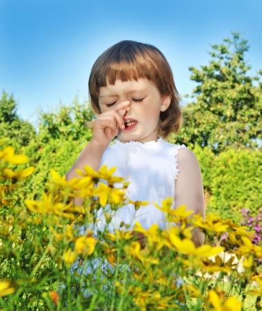 allergy: little girl sneezing - pollen fever allergy