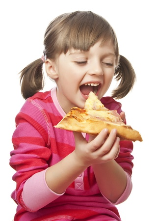 food distribution: happy little girl eating pizza - white background