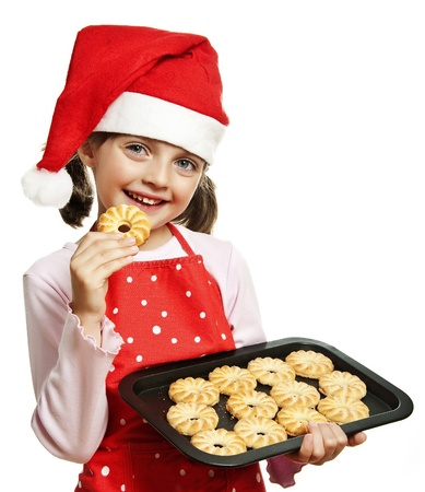 little girl baking Christmas cookies - white background