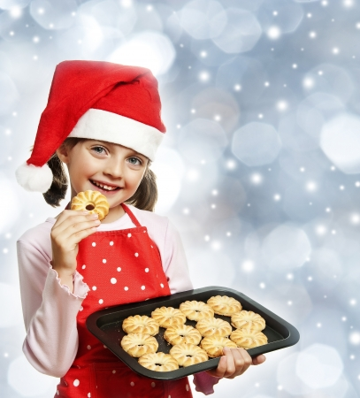 little girl baking Christmas cookies - christmas background photo
