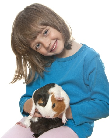 little girl and her pet a guinea pig - white background photo