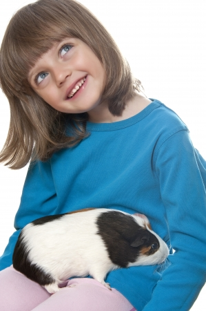 little girl and her pet a guinea pig  photo