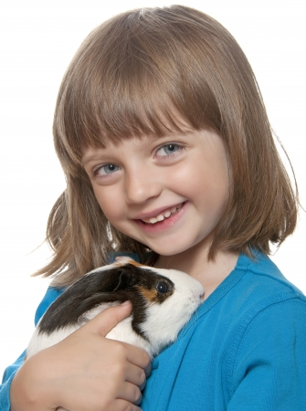 little girl and her pet - guinea pig  photo
