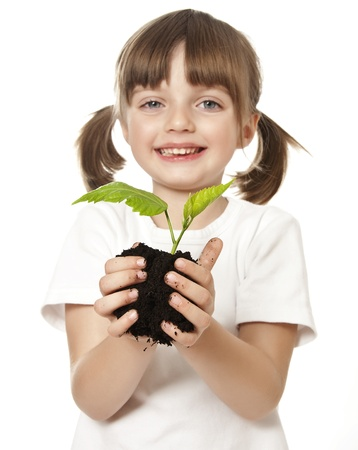 enviroment: happy little girl with plant in her hand - enviromental, concept Stock Photo