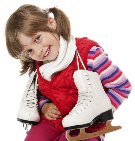 happy little girl with ice skates on white background photo
