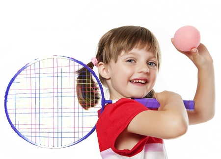 little girl holding a tennis racket and ball isolated on white background photo