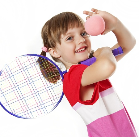 tennis racket: little girl with a tennis racket and ball isolated on white background