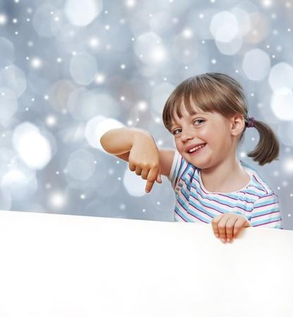 little girl pointing white blank - christmas background photo