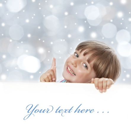 young girl with empty board - christmas background photo