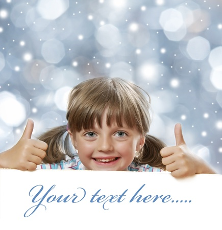 little girl and white board with empty space - christmas background Stock Photo - 18354371