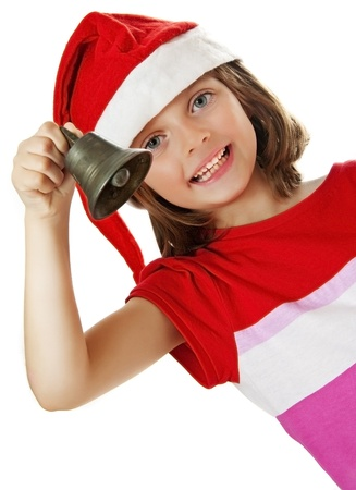 little girl with christmas bell - white background photo