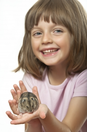 little girl holding hamster - white background photo