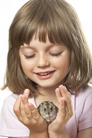 little girl holding hamster her pet  photo