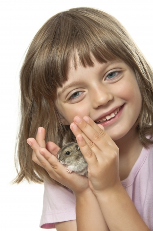 little girl holding hamster her pet animal photo