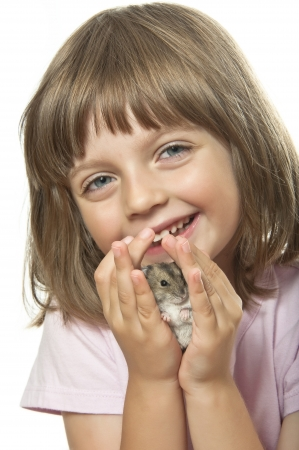 little girl holding hamster in her palms photo