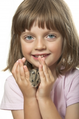little girl holding hamster isolated on white background photo