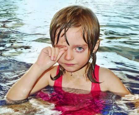 little girl five years old learning to swim is afraid of water and have allergy on chlorine disinfection in water