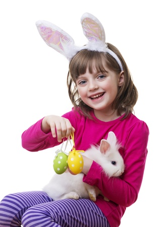bunny ears: little girl and a little white rabbit - easter play