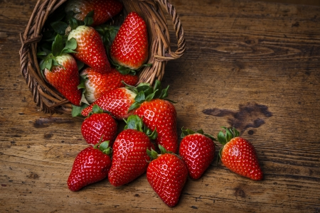 fresh garden strawberries in a basket photo